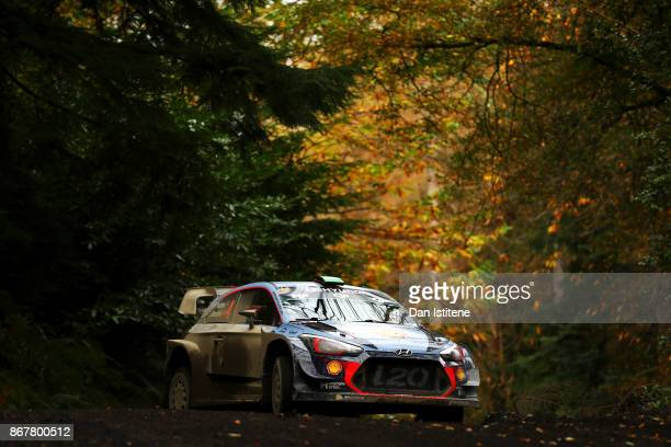 Hayden Paddon of New Zealand and Hyundai Motorsport drives with codriver Sebastian Marshall of Great Britain during day three of the FIA World Rally...