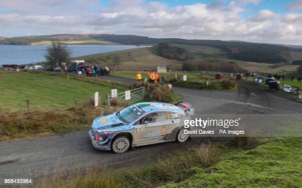 Hayden Paddon of New Zealand and Hyundai Motorsport drives with codriver Sebastian Marshall of Great Britain during day four of the Dayinsure Wales...
