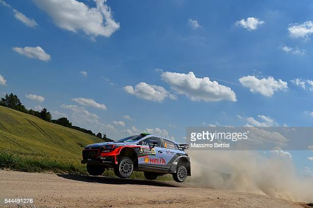 Hayden Paddon of New Zealand and John Kennard of New Zealand compete in their Hyundai Motorsport WRT Hyundai i20 WRC during Day Two of the WRC Poland...