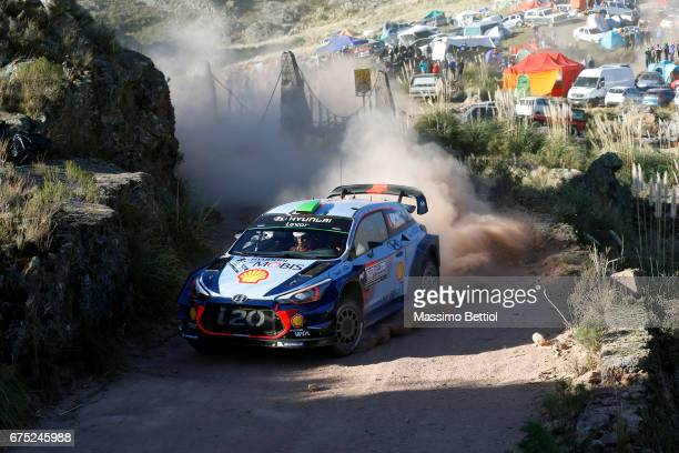 Hayden Paddon of New Zealand and John Kennard of New Zealand compete in their Hyundai Motorsport WRT Hyundai i20 WRC during Day Three of the WRC...