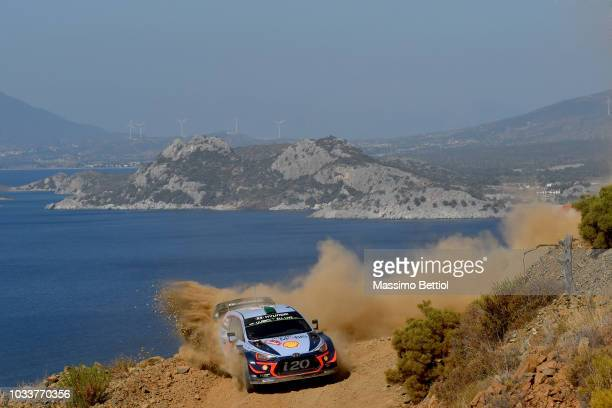 Hayden Paddon of New Zealand and Sebastian Marshall of Great Britain compete in their Hyundai Shell Mobis WRT Hyundai i20 Coupe WRC during Day Two of...