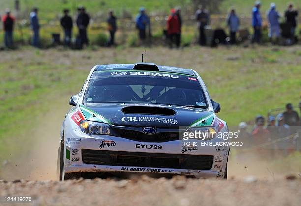USE Hayden Paddon of New Zealand powers his Subaru Impreza WRX through the Grace stage of Rally Australia round 10 of the World Rally Championship...