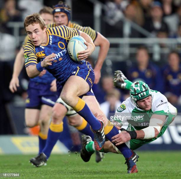 Hayden Parker of Otago attempts to bust the tackle of Callum Gibbins of Manawatuduring the round six ITM Cup match between Otago and Manawatu at...