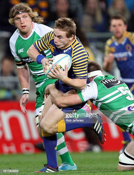 Hayden Parker of Otago attempts to bust the tackle of Michael Fitzgerald of Manawatuduring the round six ITM Cup match between Otago and Manawatu at...