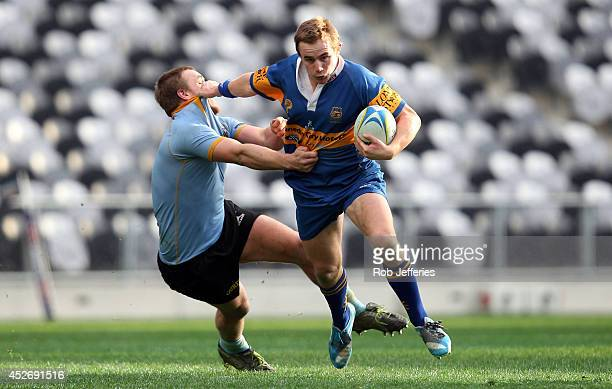 Hayden Parker of Taieri on the attack during the Dunedin Club Rugby match between University A and Taieri at Forsyth Barr Stadium on July 26, 2014 in...