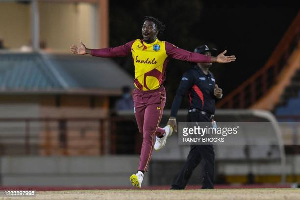 Hayden Walsh Jr. Of West Indies celebrates the dismissal of Mitchell Marsh of Australia during the 1st T20I between Australia and West Indies at...