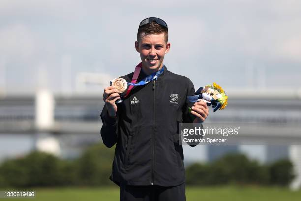 Hayden Wilde of Team New Zealand poses with the bronze medal for the Men's Individual Triathlon on day three of the Tokyo 2020 Olympic Games at...