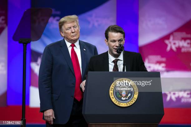 Hayden Williams a member of the Leadership Institute right speaks as US President Donald Trump listens during the Conservative Political Action...