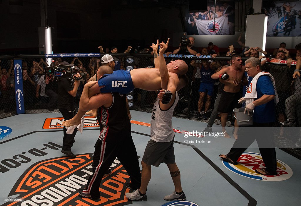 Hayder Hassan raises his hands as he waits for the judges decision after his fight against Vicente Luque during the filming of The Ultimate Fighter: American Top Team vs Blackzilians on February 27, 2015 in Coconut Creek, Florida.