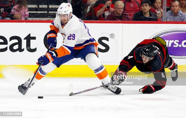 Haydn Fleury of the Carolina Hurricanes dives at Brock Nelson of the New York Islanders in Game Three of the Eastern Conference Second Round during...