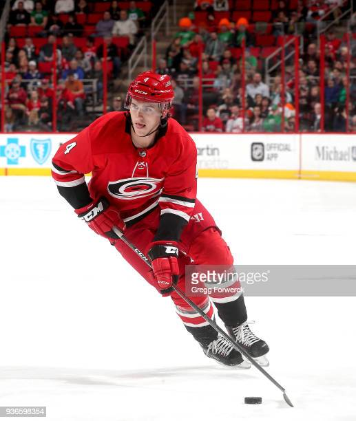 Haydn Fleury of the Carolina Hurricanes skates with the puck during an NHL game against the Philadelphia Flyers on March 17 2018 at PNC Arena in...