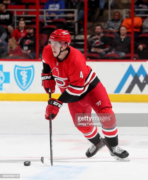 Haydn Fleury of the Carolina Hurricanes skates with the puck on the ice during an NHL game against tthe Philadelphia Flyers on March 17 2018 at PNC...