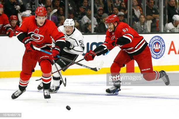 Haydn Fleury of the Carolina Hurricanes Trevor van Riemsdyk of the Carolina Hurricanes and Austin Wagner of the Los Angeles Kings fight for control...
