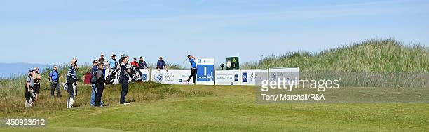 Haydn McCullen of Delamere Forest plays his first shot on the 1st tee during The Amateur Championship 2014 Day Five at Royal Portrush Golf Club on...