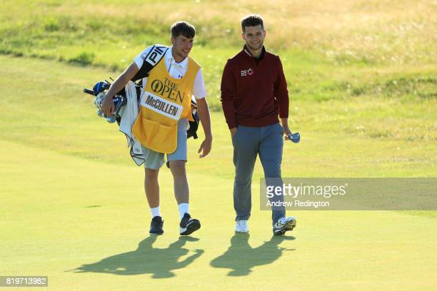 Haydn McCullen of England walks with his caddie during the first round of the 146th Open Championship at Royal Birkdale on July 20 2017 in Southport...