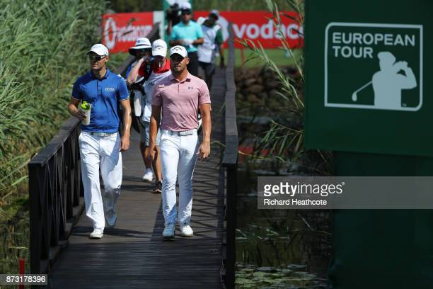 Haydn Porteous of South Africa and Martin Kaymer of Germany walk down the 16th hole during the final round of the Nedbank Golf Challenge at Gary...