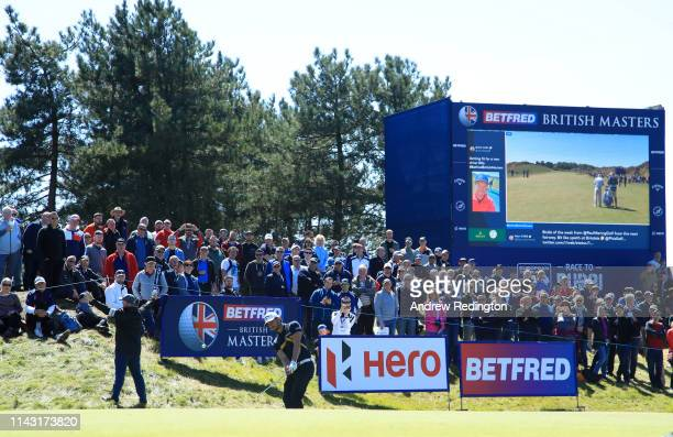 Haydn Porteous of South Africa hits his second shot on the 16th hole during day four of the Betfred British Masters at Hillside Golf Club on May 12,...