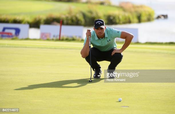 Haydn Porteous of South Africa lines up a putt on the 18th green during the final round on day four of the DD REAL Czech Masters at Albatross Golf...