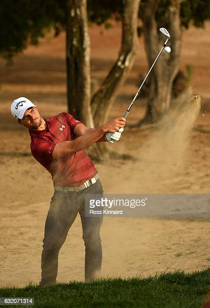 Haydn Porteous of South Africa plays his fourth shot on the eighth hole during the first round of the Abu Dhabi HSBC Championship at the Abu Dhabi...