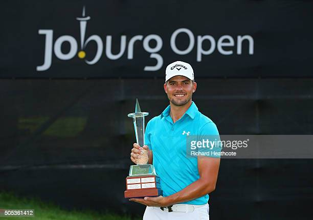Haydn Porteous of South Africa poses with the trophy after his victory on the East Course during day four and the final round of the Joburg Open at...