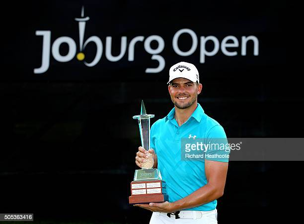 Haydn Porteous of South Africa poses with the trophy after his victory on the East Course during the final round of the Joburg Open at Royal...