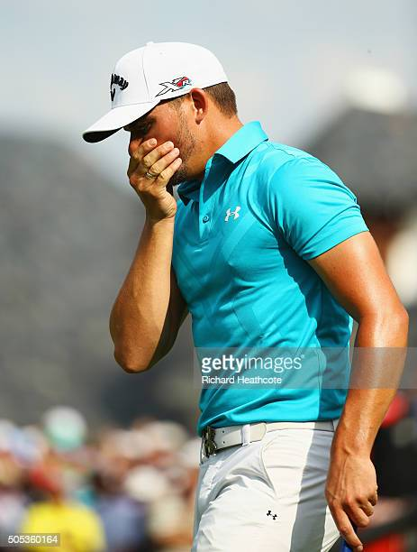 Haydn Porteous of South Africa reacts after victory on the 18th green on the East Course during day four and the final round of the Joburg Open at...