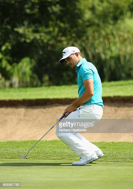 Haydn Porteous of South Africa reacts as he misses a birdie putt on the 13th green on the East Course during day four and the final round of the...