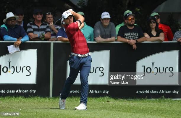 Haydn Porteous of South Africa tees off on the 1st during completion of the suspended third and final round of The Joburg Open at Royal Johannesburg...