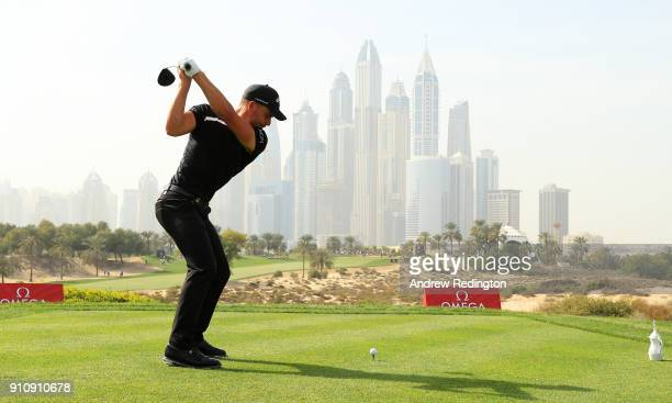 Haydn Porteous of South Africa tees off on the 8th hole with the city as a backdrop during day three of Omega Dubai Desert Classic at Emirates Golf...