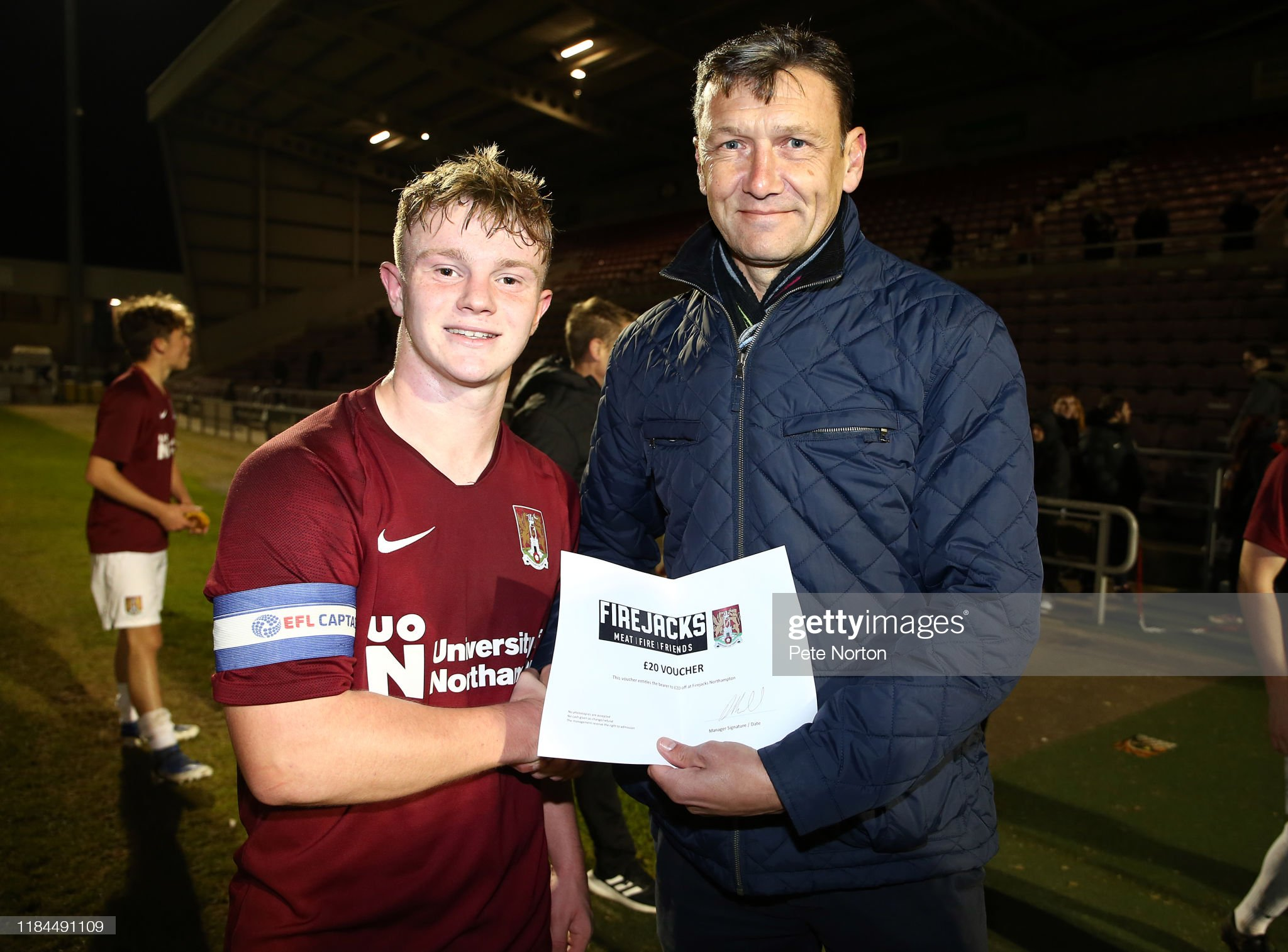 https://media.gettyimages.com/photos/haydn-price-of-northampton-town-receives-his-player-of-the-match-picture-id1184491109?s=2048x2048