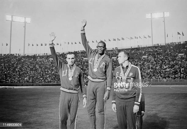 Hayes Jones of the United States celebrates his gold medal alongside compatriot and silver medallist Blaine Lindgren and third placed bronze...