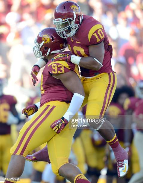 Hayes Pullard of the USC Trojans celebrates the sack of Greg Townsend Jr #93 against the Hawaii Warriors at Los Angeles Coliseum on September 1 2012...