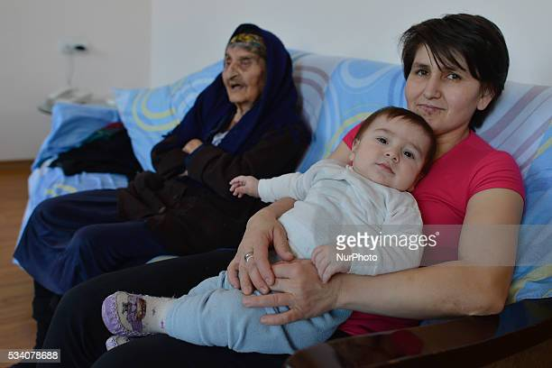 Hayka Sargsyan with Narine Ohanyan the wife of her grand son and grandgrand son Hacob inside a hotel room in Stepanokert The family was evacuated...