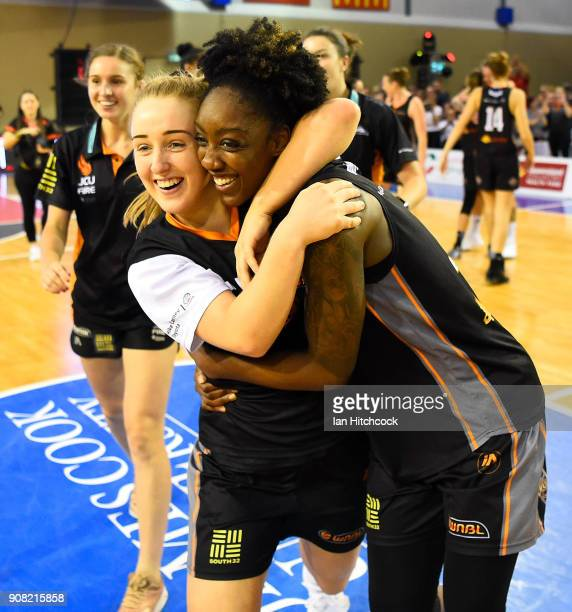 Haylee Andrews and Laurin Mincy of the Fire celebrate after winning game three of the WNBL Grand Final series between the Townsville Fire and...