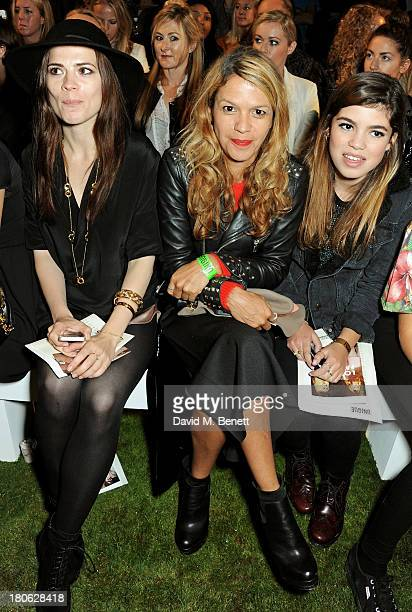 Hayley Atwell Lisa Moorish and Molly Gallagher attend the Unique SS14 runway show during London Fashion Week on September 15 2013 in London England