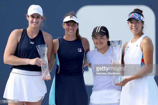 Hayley Carter and Luisa Stefani of Brazil pose with Shuko Aoyama and Ena Shibahara of Japan at the trophy ceremony during the doubles final of the...