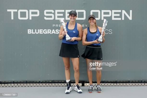Hayley Carter and Luisa Stefani of Brazil pose with the trophies after defeating Marie Bouzkova of the Czech Republic and Jil Teichmann of...