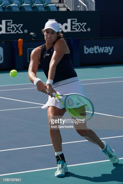 Hayley Carter hits a backhand during the womens doubles finals of the Miami Open on April 4 at Hard Rock Stadium in Miami Gardens, Florida