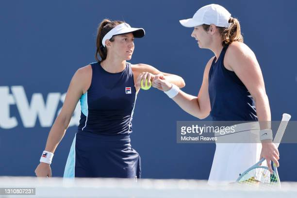 Hayley Carter of the United States and Luisa Stefani of Brazil confer against Ena Shibahara and Shuko Aoyama of Japan during the final of the Miami...