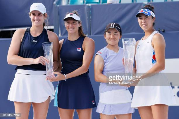 Hayley Carter of the United States and Luisa Stefani of Brazil pose with the finalist trophy next to Ena Shibahara and Shuko Aoyama of Japan with the...