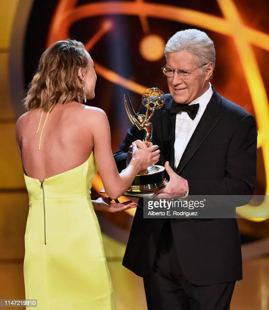 Hayley Erin accepts the Daytime Emmy Award for Outstanding Younger Actress in a Drama Series from Alex Trebek onstage during the 46th annual Daytime...