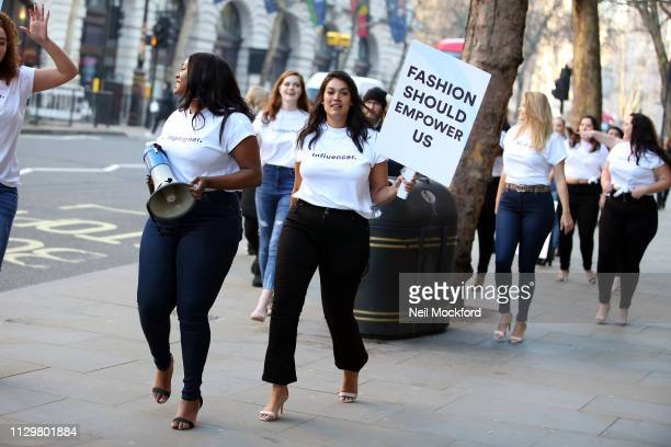 Hayley Hasslehoff and defiant curvy models protest in front of campaign bus outside the BFC Show Space at LFW February 2019 on February 15, 2019 in...