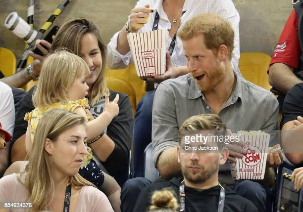 Hayley Henson and daughter Emily Henson sit with Prince Harry at the Sitting Volleyball Finals during the Invictus Games 2017 at Mattamy Athletic...