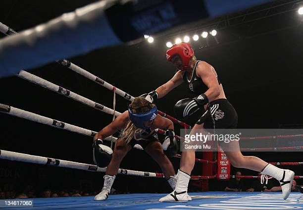 Hayley Holt punches Paige Hareb during the Fight For Life League vs Union Night at The Trusts Stadium on December 3 2011 in Auckland New Zealand