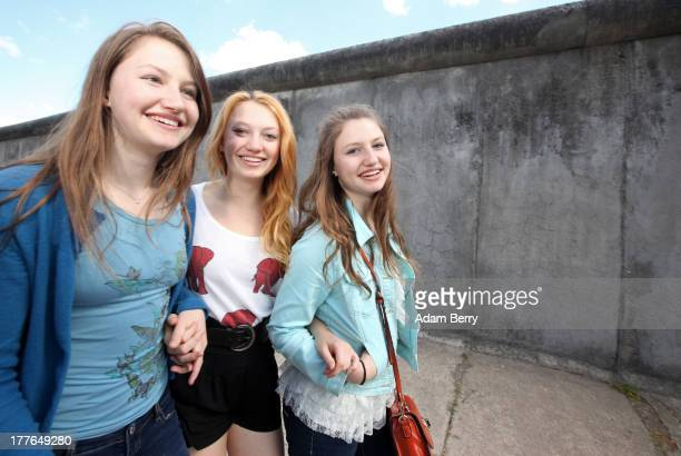 Hayley, Jacqueline, and Taylor, daughters of John B. Emerson, designated U.S. Ambassador to Germany, visit the Berlin Wall Memorial during a tour of...
