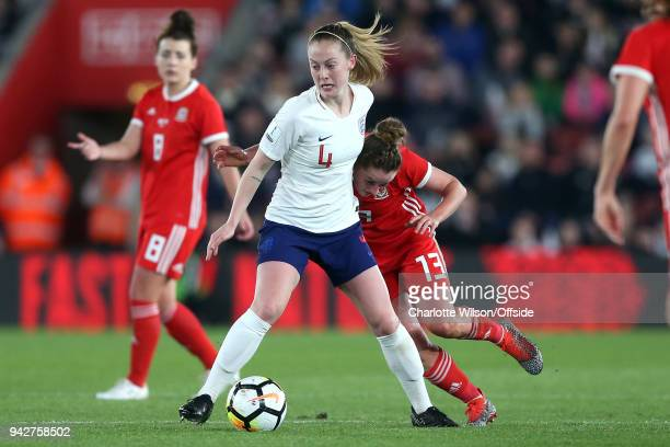 Hayley Ladd of Wales collides with Keira Walsh of England during the Womens World Cup Qualifier between England and Wales Women at St Mary's Stadium...