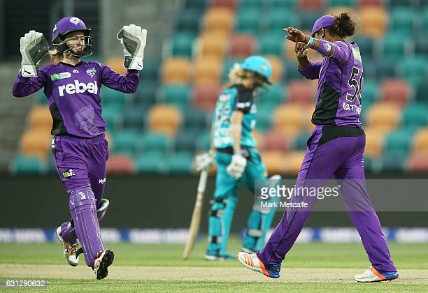 Hayley Matthews of the Hurricances does a dab celebration after taking a catch to dismiss Laura Harris of the Heat during the Women's Big Bash League...