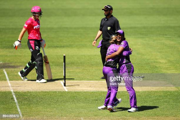 Hayley Matthews of the Hurricanes celebrates the run out Sarah Aley of the Sixers as Aley leaves the field dejected during the Women's Big Bash...