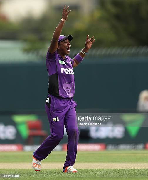 Hayley Matthews of the Hurricanes takes the wicket of Natalie Sciver of the Melbourne Stars during the Women's Big Bash League match between the...