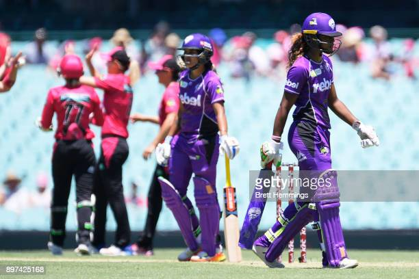 Hayley Matthews of the Hurricanes walks from the field after being dismissed by Sarah Aley of the Sixers during the Women's Big Bash League match...